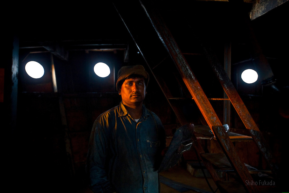 A labor works in a ship yard in Dhaka, Bangladesh.