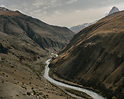 """Wakhan river below. Trekking from Shaur camp across Baharak, to the valley of Sang Nevishta (meaning """"Written Stones""""). Guiding and photographing Paul Salopek while trekking with 2 donkeys across the """"Roof of the World"""", through the Afghan Pamir and Hindukush mountains, into Pakistan and the Karakoram mountains of the Greater Western Himalaya. Wakhan Corridor."""