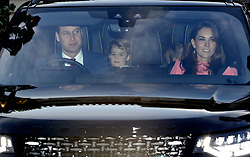 The Duke of Cambridge, Prince George and the Duchess of Cambridge leaving the Queen's Christmas lunch at Buckingham Palace, London.