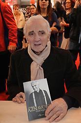 Charles Aznavour signing copies of his book during 32th Paris Book Fair (Salon du Livre de Paris) held at the Parc des Expositions, Porte de Versailles in Paris, France on March 17, 2012. Photo by Giancarlo Gorassini/ABACAPRESS.COM