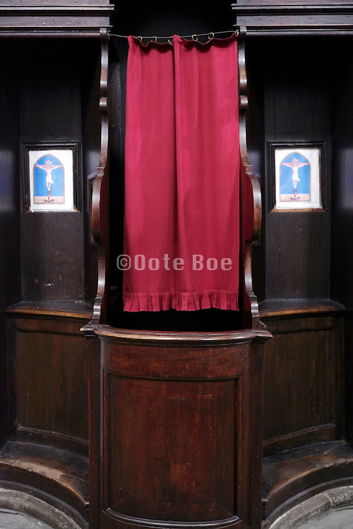 close up of confessional with a red curtain