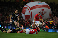 Leigh Halfpenny of Wales gets the ball out to Jamie Roberts ©. RBS Six nations championship 2012, Wales v Scotland at the Millennium Stadium in Cardiff on Sunday 12th Feb 2012.  pic by Andrew Orchard, Andrew Orchard sports photography,
