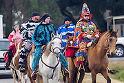 Traditional Cajun Mardi Gras costumed riders on horseback during the Courir de Mardi Gras chicken run on Fat Tuesday February 17, 2015 in Eunice, Louisiana. Cajun Mardi Gras involves costumed revelers competing to catch a live chicken as they move from house to house throughout the rural community.