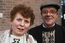Portrait of elderly couple standing outdoors,