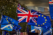 Union Jacks and the European flags flying together for the Together for the final say march for a People¹s Vote on 19th October 2019 in London, United Kingdom. On this day parliament will be sitting on a Saturday for the first time since the 1980s, as time runs out before the PM is supposed to ask the EU for a three month extension by law under the Benn Act. With less than two weeks until the UK is supposed to be leaving the European Union, the final result still hangs in the balance and protesters gathered in their hundreds of thousands to make political leaders take notice and to give the British public a vote on the final Brexit deal, with the aim to revoke Article 50.
