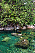 Emerald green pools in Gold Creek Golden Ears Park near Maple Ridge, British Columbia, Canada.  The colour here is from minerals suspended in Gold Creek's water from its journey down from the Coast Mountains.
