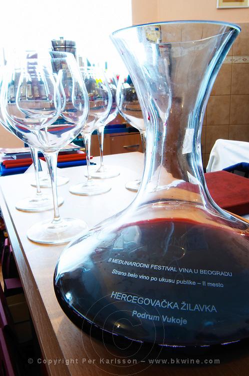 A decanter carafe with red wine and wine tasting glasses. , in the winery tasting room. Vukoje winery, Trebinje. Republika Srpska. Bosnia Herzegovina, Europe.