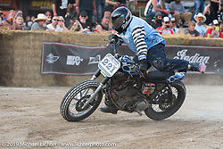 Hooligan flattracker (no. 221) Rich Silva flies off his Harley-Davidson Sportster racer in the Hooligan races on the temporary track in front of the Sturgis Buffalo Chip main stage during the Sturgis Black Hills Motorcycle Rally. SD, USA. Wednesday, August 7, 2019. Photography ©2019 Michael Lichter.