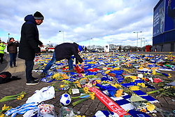 A Cardiff City fan places a Bournemouth scarf on the Emiliano Sala memorial at the Premier League match at the Cardiff City Stadium.