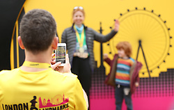 A runner takes a photograph during the 2018 London Landmarks Half Marathon. PRESS ASSOCIATION Photo. Picture date: Sunday March 25, 2018. Photo credit should read: Steven Paston/PA Wire