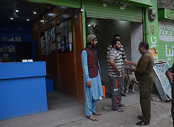 June 17, 2017 - Lahore, Punjab, Pakistan - Pakistani security personnel busy in searching and clear the market near Imambargah karbala Gamay shah before procession, Youm-e-Ali. Youm-e-Ali (RA)the martyrdom day of Hazrat Ali (RA) processions is being observed today (Saturday) with religious harmony  amid tight security across the country. (Credit Image: © Rana Sajid Hussain/Pacific Press via ZUMA Wire)