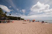 Waikiki Beach with clouds in the sky.