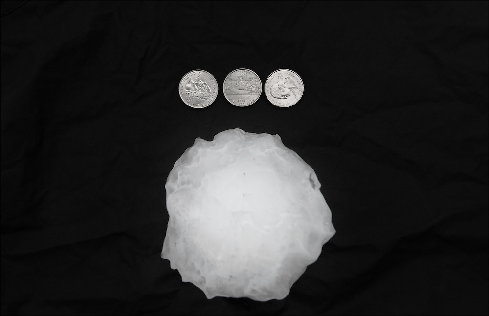 large destructive hail with a diameter larger then three quarters that caused total destruction in Wylie, Texas.