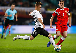 November 15, 2018 - Leipzig, Germany - Joshua Kimmich (C) of Germany and Yury Gazinsky of Russia in action during the international friendly match between Germany and Russia on November 15, 2018 at Red Bull Arena in Leipzig, Germany. (Credit Image: © Mike Kireev/NurPhoto via ZUMA Press)