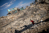 A man is seen working on the rubble of the Al Wafa hopsital bombed by IDF