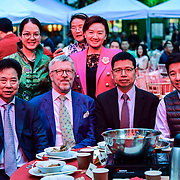 Chu Ting Tang of London Chinatown Chinese  Association with Honourable  Chinese Minister Counsellor , Consular and Overseas Chinese Affairs Mr. Tong Xuejun (童学军) Tim Michelle  attend the Celebration of the Moon festival - The big feast for the chinese community and the 70th Anniversary of China at Chinatown Square on the 15th September 2019, London, UK.