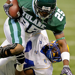 Sep 26, 2009; New Orleans, LA, USA;  McNesse State Cowboys safety Malcolm Bronson (34) tackles Tulane Green Wave running back Albert Williams (25) at the Louisiana Superdome. Tulane defeated McNeese State 42-32. Mandatory Credit: Derick E. Hingle-US PRESSWIRE