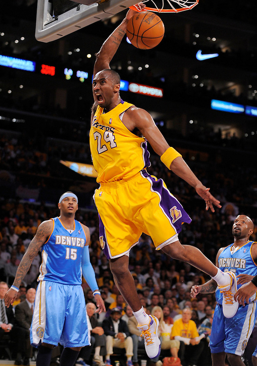 The Lakers' Kobe Bryant dunks two of his first half points Tuesday during the Lakers' 105-103 victory over the Denver Nuggets...///ADDITIONAL INFO:  lakers.0520.kjs13.jpg  ---  Photo by Kevin Sullivan, The Orange County Register --  ..The Los Angeles Lakers take on the Denver Nuggets in Game 1 of the Western Conference Finals Tuesday May 19, 2009 at Staples Center..