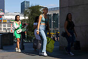 Young women carrying shopping bags from fashion retailers away from the Arndale centre on 26th August, 2021 in Manchester, United Kingdom. Many of the UKs high streets and shopping centres are bustling once again, welcoming shoppers back as footfall slowly climbs back to levels seen before the restrictions brought about by the Covid-19 pandemic.