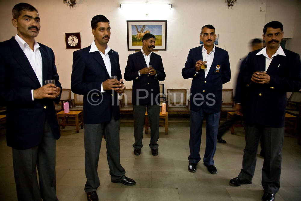 Non commissioned officers (NCO's) of the Presidential Bodyguard regiment having a drink in their mess after a full day's activities in HQ's, New Delhi. The  Presidential Bodyguard or PBG is the Indian Army's preeminent regiment founded in 1773 during the British occupation, this handpicked unit began with a mere 50 men and today stands at 160 soldiers plus 50 support staff. It has a dual role, both as a ceremonial guard for the President of India, with all its finery at important state functions, as well as an elite operational unit for the Indian Army which has seen action in many battle fronts, in particular the on going disputed region of Kashmir.