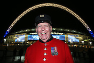 a Chelsea pensioner poses for a photo outside Wembley Stadium before k/o. UEFA Champions league match, group E, Tottenham Hotspur v CSKA Moscow at Wembley Stadium in London on Wednesday 7th December 2016.<br /> pic by John Patrick Fletcher, Andrew Orchard sports photography.