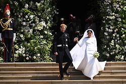 Britain's Prince Harry (L), Duke of Sussex and Meghan (R), Duchess of Sussex exit St George's Chapel in Windsor Castle after their royal wedding ceremony, in Windsor, Britain, 19 May 2018. The couple have been bestowed the royal titles of Duke and Duchess of Sussex on them by the British monarch. Photo by Neil Hall / ABACAPRESS.COM  | 637700_008 WINDSOR Royaume Uni United Kingdom