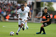 Leroy Fer of Swansea city goes past Mikel Merino of Newcastle Utd (r). Premier league match, Swansea city v Newcastle Utd at the Liberty Stadium in Swansea, South Wales on Sunday 10th September 2017.<br /> pic by  Andrew Orchard, Andrew Orchard sports photography.