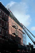 4 Alarm Fire blazes through building at 240 Ave A at Houston Street in New York City on July 8, 2010