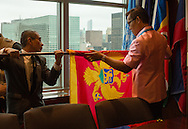 United Nations Protocol Assistants   Roderick Santos,left,and Gavin Pan roll up the national flag of Montenegro.