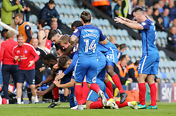 Junior Morias of Peterborough United is mobbed by team-mates after scoring his second goal of the game - Mandatory by-line: Joe Dent/JMP - 23/09/2017 - FOOTBALL - ABAX Stadium - Peterborough, England - Peterborough United v Wigan Athletic - Sky Bet League One