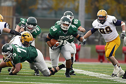 12 November 2011:  A well protected Sean Conley makes a move through the middle during an NCAA division 3 football game between the Augustana Vikings and the Illinois Wesleyan Titans in Tucci Stadium on Wilder Field, Bloomington IL