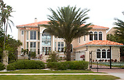 Gated mansion overlooking the Gulf Boulevard and Gulf of Mexico.  Belleair Beach Tampa Bay Area Florida USA