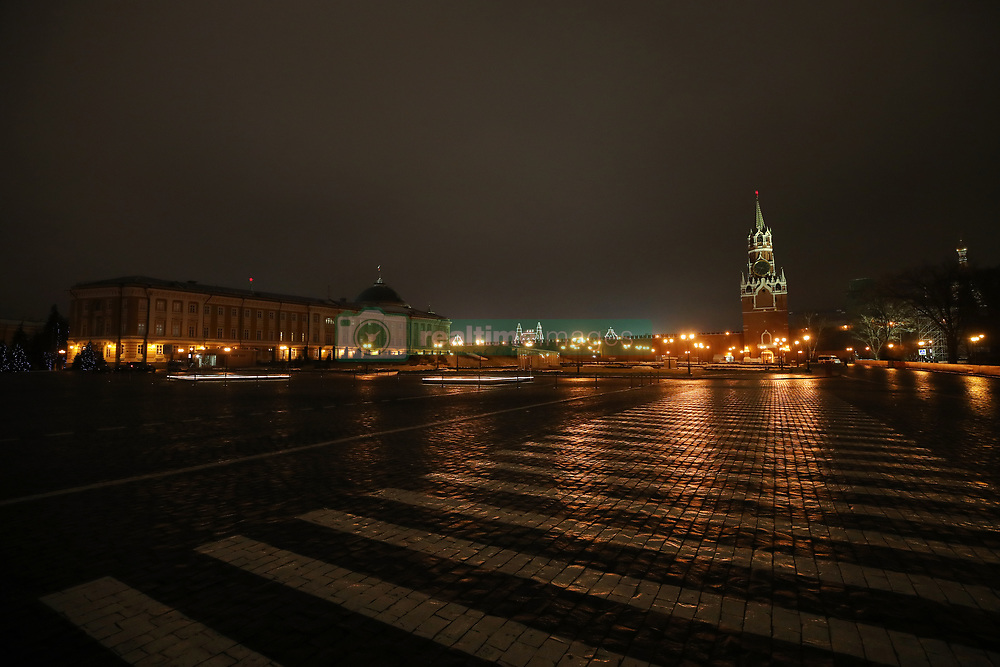 General view inside the walled area of the Kremlin at night looking out onto Cathedral of Vasily the Blessed and the Gum Shopping centre Christmas market on Red Square
