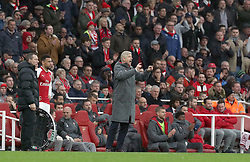 Arsenal manager Arsene Wenger gestures on the touchline as Francis Coquelin (left) prepares to come on during the Premier League match at the Emirates Stadium, London.