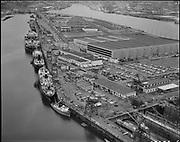 "Ackroyd 13232-06. ""Port of Portland. Aerials of 'Manhattan' at Swan Island. April 19, 1965"" (ship repair on lagoon side of Swan Island)"