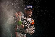 Klaus Graf, Muscle Milk Pickett Racing (P1) celebrates on the podium Petit Le Mans. Oct 18-20, 2012. © Jamey Price