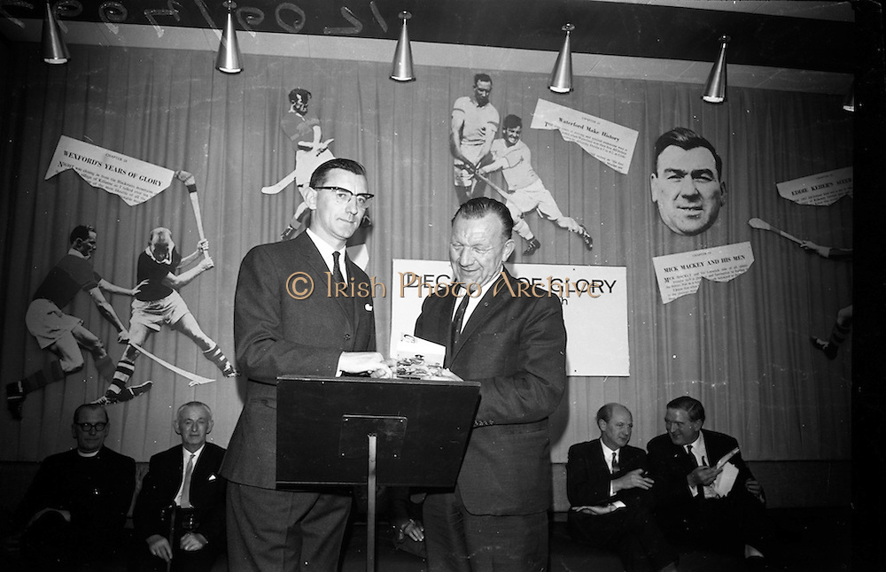 """17/05/1966<br /> 05/17/1966<br /> 17 May 1966<br /> Book reception for """"Decades of Glory: A Comprehensive History of the National Game"""" by Raymond Smith.<br /> This reception was held in the offices of W.D. & H.O. Wills to honour the well known author and journalist, Raymond Smith. His book on the history of Hurling (""""Decades of Glory"""") has just been published with the assistance of Wills of Dublin and Cork and the Central Council of the G.A.A.<br /> Author, Raymond Smith (left) presents his book to  Seán Ó Síocháin, General Secretary of the G.A.A."""