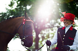 © Licensed to London News Pictures. <br /> 29/07/2014. <br /> <br /> Kirkbymoorside, United Kingdom<br /> <br /> A woman holds a pony as it is prepared for her round during the Ryedale agricultural show in North Yorkshire. The show was established in 1855 and is a traditional agricultural show renowned for its high standards of entries into the numerous livestock categories.<br /> <br /> Photo credit : Ian Forsyth/LNP