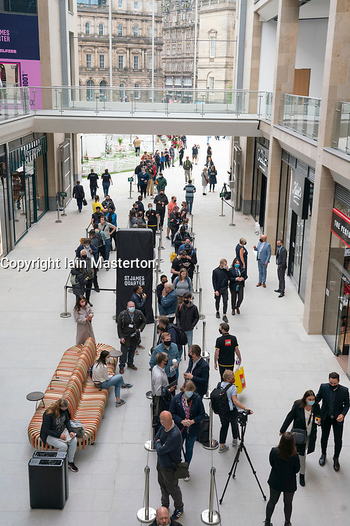 Edinburgh, Scotland, UK. 24 June 2021. First images of the new St James Quarter which opened this morning in Edinburgh. The large retail and residential complex replaced the St James Centre which occupied the site for many years. Pic; Queues formed early outside the Lego store. Iain Masterton/Alamy Live News
