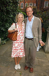 MARIELLA FROSTRUP and her husband JASON McCUE at the annual Macmillan Cancer Support House of Lords vs the House of Commons Tug of War held in Victoria Tower Gardens on 20th June 2006.<br /><br />NON EXCLUSIVE - WORLD RIGHTS