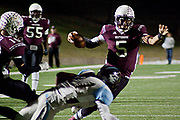 Patrick Mahomes evades Seguin defenders during their game against the Cougars at Mesquite Mwmorial Stadium on Friday.© 2013 Jaime R. Carrero/Carrero Photography
