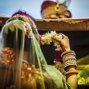 Jai Mala (Exchange of Garlands):  the bride and groom exchange floral garlands, signifying their acceptance of one another. The friends try to make the exchange more playful and fun by lifting the couple up in the air and pulling them away from each other.