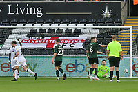Football - 2021 / 2022 EFL Carabao Cup - Round Two - Swansea City vs Plymouth Argyle - Liberty Stadium - Tuesday 24th August 2021<br /> <br /> Daniel Patrick Williams Swansea City celebrates scoring his team's first goal Callum Burton Plymouth Argyle sits on floor, ball inback of  net<br /> <br /> COLORSPORT/WINSTON BYNORTH