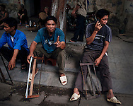 Workers offering their services sit in a street of Hanoi, Vietnam, Southeast Asia, 2009