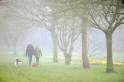 © Licensed to London News Pictures. 12/03/2016<br /> A couple walk their dog through heavy fog in Foots Cray Meadows  in  Sidcup, Kent this morning. Photo credit: Grant Falvey