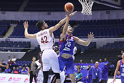 September 17, 2018 - Quezon City, NCR, Philippines - Japeth Aguilar (Blue) of the Philippines gets fouled by Nasser Khaifa Al-Rayes (White) of Qatar. (Credit Image: © Dennis Jerome S. Acosta/Pacific Press via ZUMA Wire)
