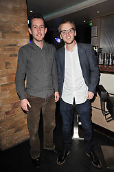 Left to right, CARBYN HILL and JONNIE HORNER at a screening hosted by 'The Volunteer' of a documentary film of work in Haiti, held at the Courthouse Hilton Hotel, 19-21 Great Malborough Street, London on 29th March 2011.