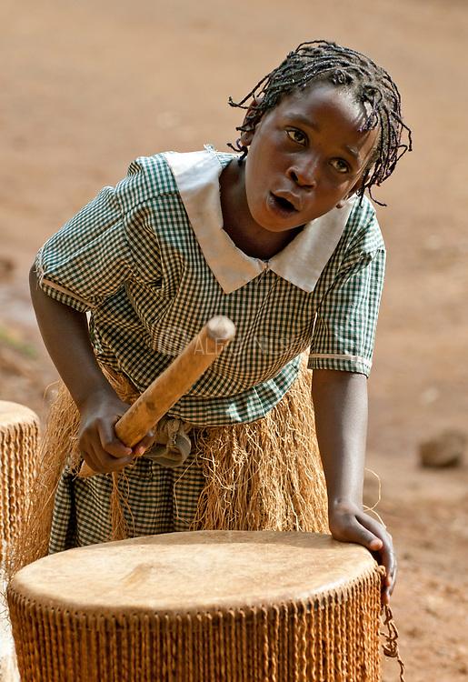 Drummer girl from Bwindi, Uganda.