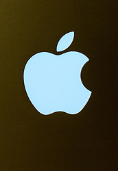 File photo dated 29/12/12 of the Apple logo displayed on a Mac Book Pro. The iPhone maker beat analyst expectations in its latest financial results as the technology giant's revenue rose 7\% on last year.