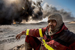 November 23, 2016 - Qayyara, Ninewa Province, IRAQ - Firefighters from the city of Kirkuk, Iraq who specialize in the disposal of oil field fires have been fighting The Qayyara fires for months. They claim that it will take many months more. These massive fires are now visible from space. (Credit Image: © Gabriel Romero via ZUMA Wire)